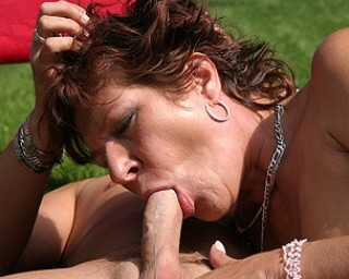 Kinky mama fucking outside on an open field